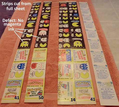 Strips from uncut sheet of Fleer Pac-Man stickers, with missing magenta ink